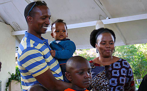 Leshan being held by his dad, his mother Joy and cousin Levi.