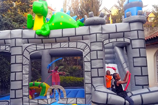 The bouncing castle. I must be behind news because nowadays  bouncing castles come complete with an inbuilt slide? Okay.