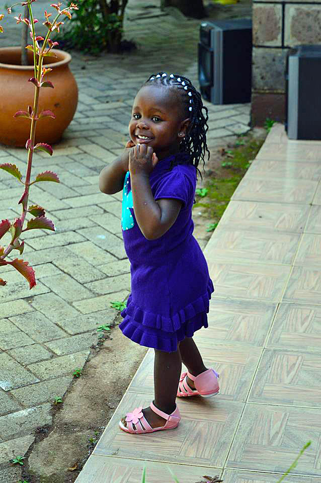 Here, Sanaa rocks a purple sweater dress from Baby Shop and pink gladiator sandals from House of Leather.
