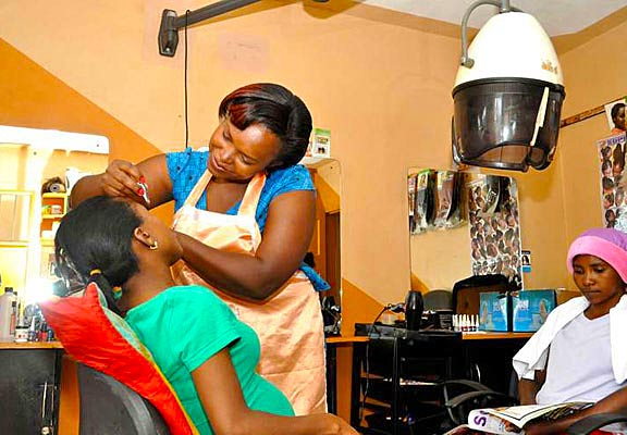 Milka Kihara attending to a client at her own salon.