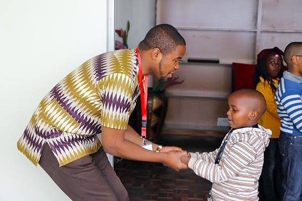 Johnson Mwakazi training a young boy during the last kids camp.