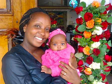 Joy Wanja Muraya with daughter Shantelle. She juggled exclusive breastfeeding with work and her Masters degree in Public Health where she would take evening classes.