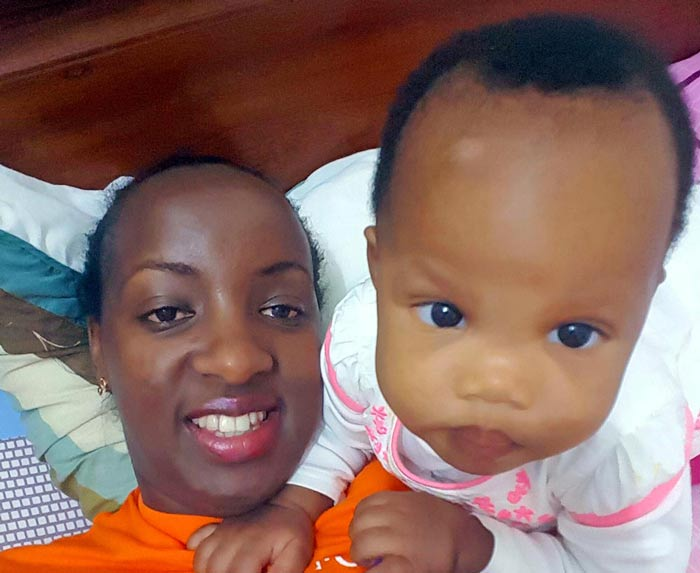 Helen with her daughter at 9 months.