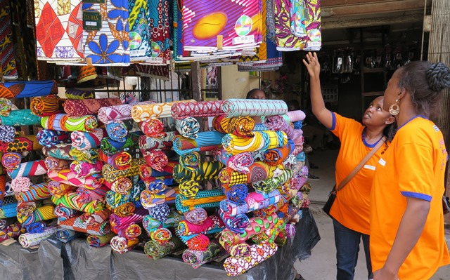 A Kitenge fabric or tailored outfit for her and/or her mom will be a good idea.
